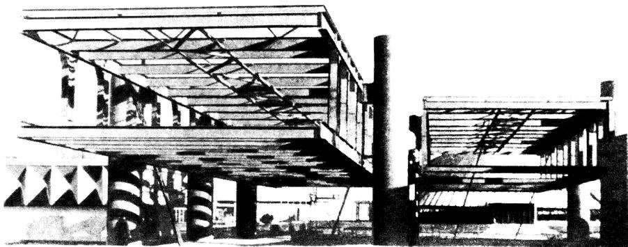 Стальные конструкции верхнего этажа, подвешенные между цилиндрическими стальными колоннами