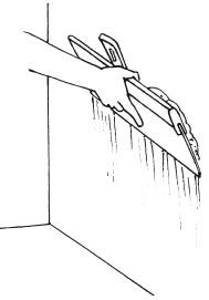Рис.35. Нанесение шпаклевки на поверхность стены